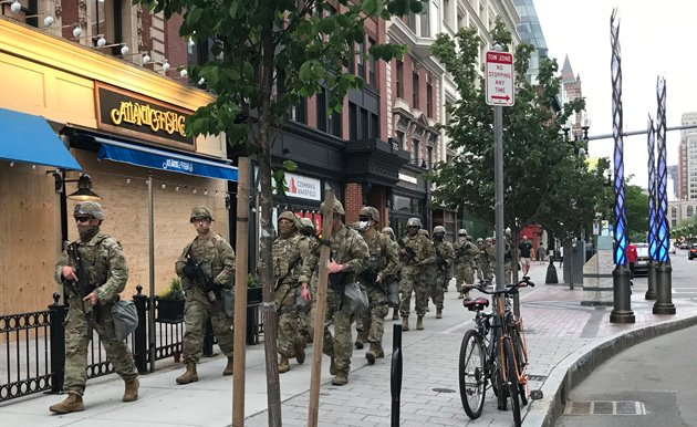 National Guardsmen march past Boston Marathon bombing memorial