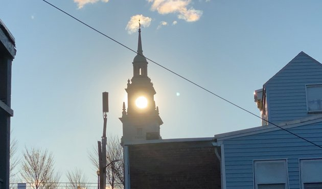 Sun shines through Dorchester Heights Monument this morning