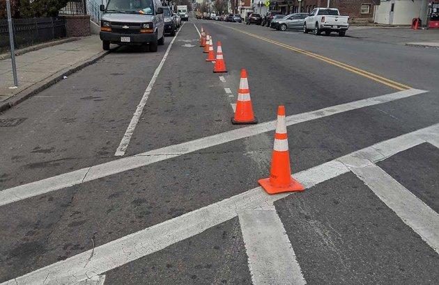 Traffic cones set out by bicyclist to protect bike lane in Dorchester