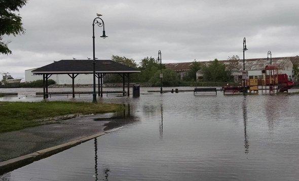 Flooded playground at Tenean Beach in Dorchester