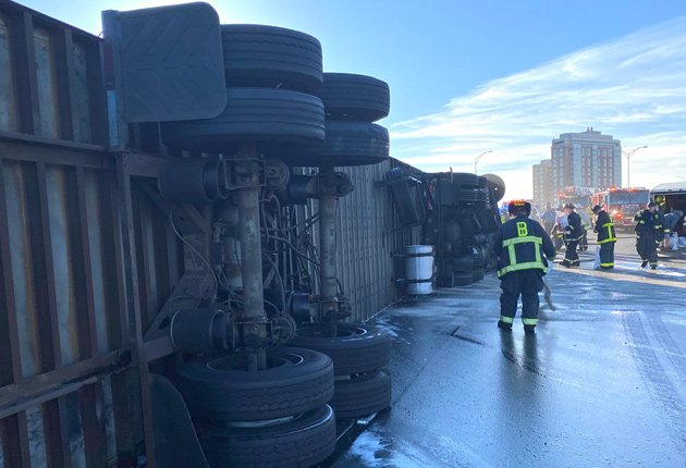 Rolled over truck on I-90 eastbound in Allston