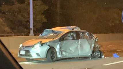 Smashed car on Massachusetts Turnpike