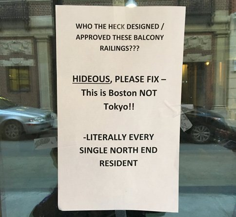 Get rid of these stupid railings - Boston is not Tokyo - sign says