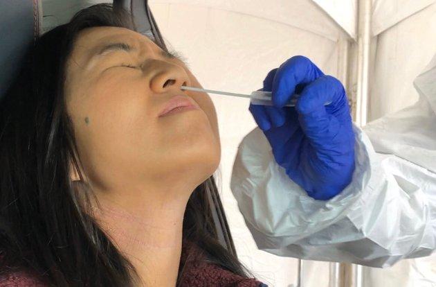 Michelle Wu getting a coronavirus test