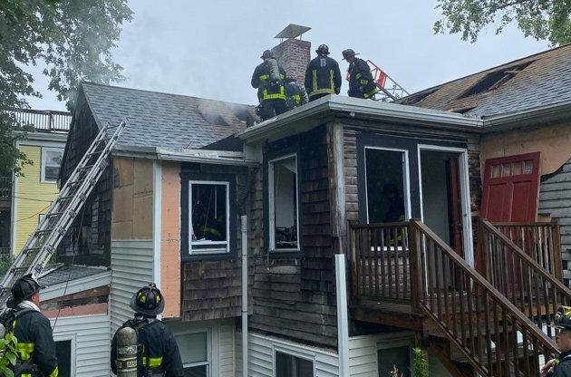 Firefighters at Adams Street fire
