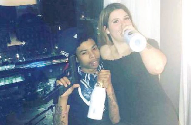 Couple with gun and Belair champagne