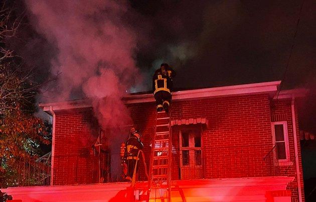 Firefighters at 519 Poplar St. fire