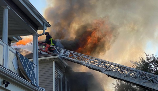Firefighters at fire at 69 Floyd St. in Dorchester