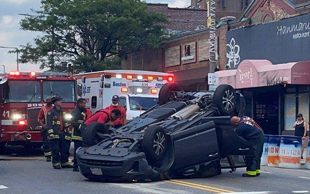 Overturned car on Harvard Avenue