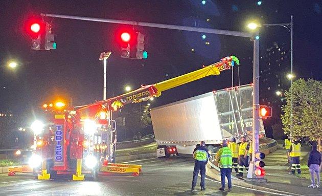 Big crane lifts big truck