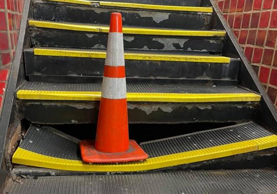 Broken Park Street step with cone