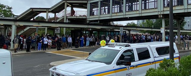People waiting for non-existent shuttle bus at JFK/UMass