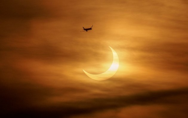 Morning eclipse, with jet