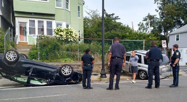 Flipped car on Hyde Park Avenue