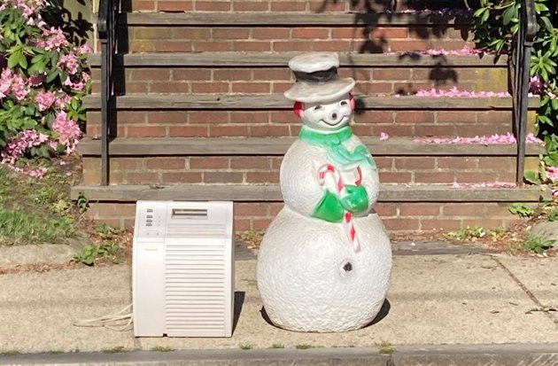 Snowman figure and an air conditioner