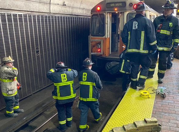 Firefighters on the Orange Line at Jackson Square