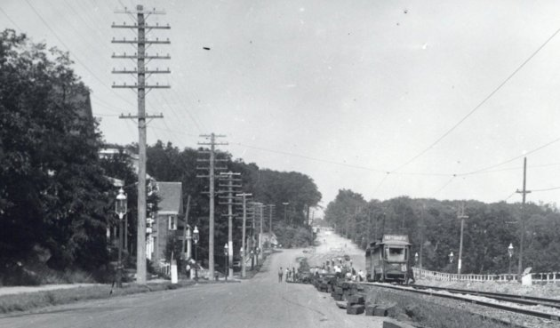 Workers extending a trolley line in old Boston