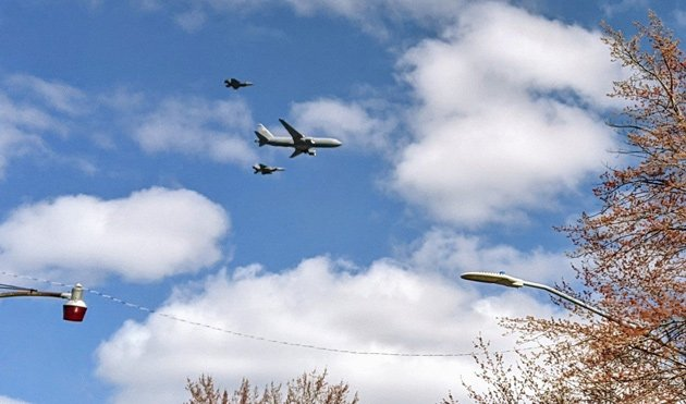 Fighter jets and a tanker plane