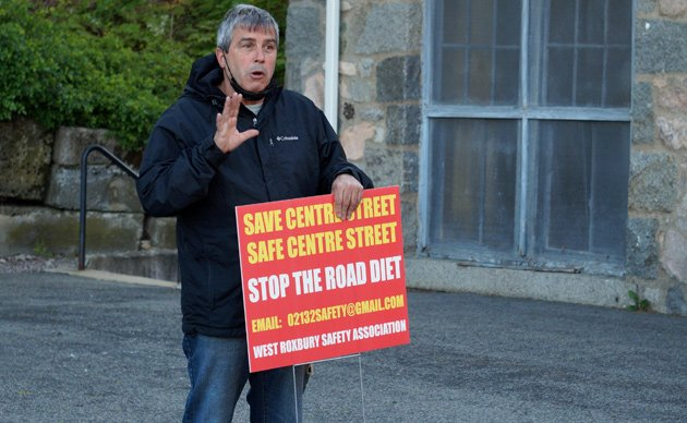Stephen Morris with a new sign against Centre Street bike lanes