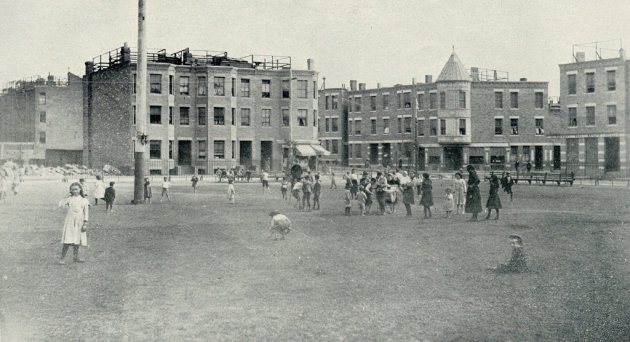 Kids on play field in old Boston