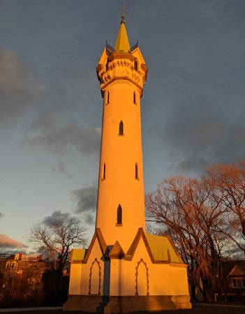 Orange Fort Hill water tower at sunset
