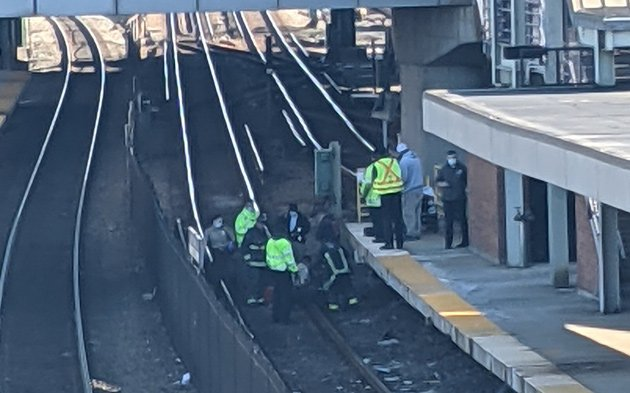 Crews getting person off tracks at JFK/UMass