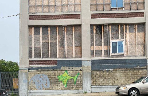 Graffiti on plywood building on Porter Street in East Boston