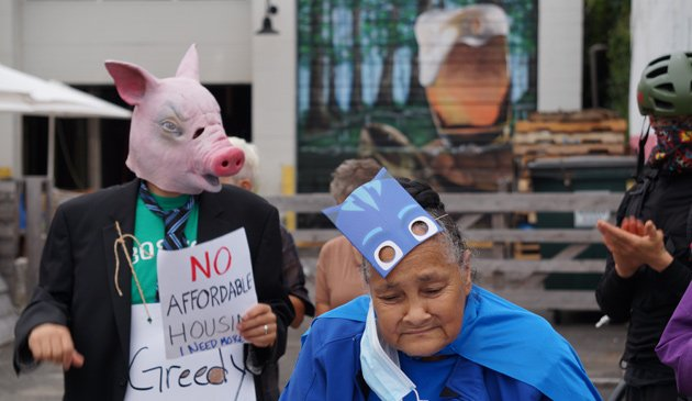 Pig and senior protest lawsuit against senior housing in Jamaica Plain