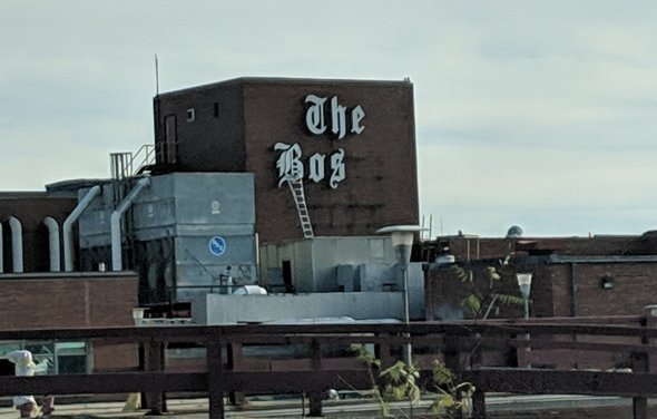 Boston Globe logo being removed from former plant in Dorchester