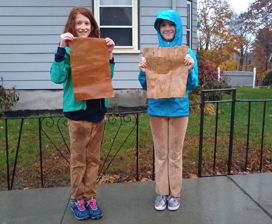 Two kids with pro trans rights signs