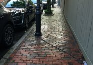 Electric-car charging cord on sidewalk