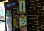 Phone booth and Latin saying outside Shaw's in Hyde Park