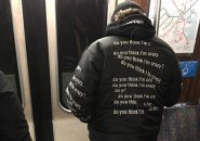 Man on Orange Line with jacket that asks if you think he's crazy
