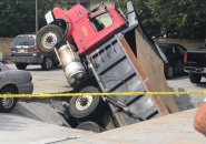 Dump truck falls through Quincy garage