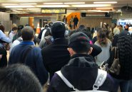 People waiting at Malden Center on the Orange Line