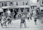 Kids on seesaws in old Boston