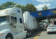 Truck wedged under an Orange Street bridge in Malden