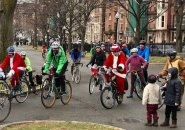 Santa on a bicycle on Commonwealth Avenue in the Back Bay