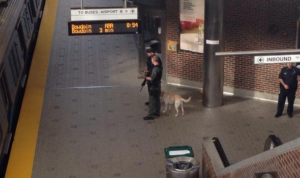 Police with guns at Airport station