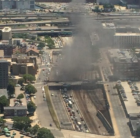 Smoke rises from turnpike car fire in Boston