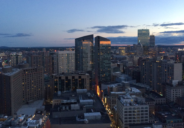 Boston towers at night from the Millennium Tower