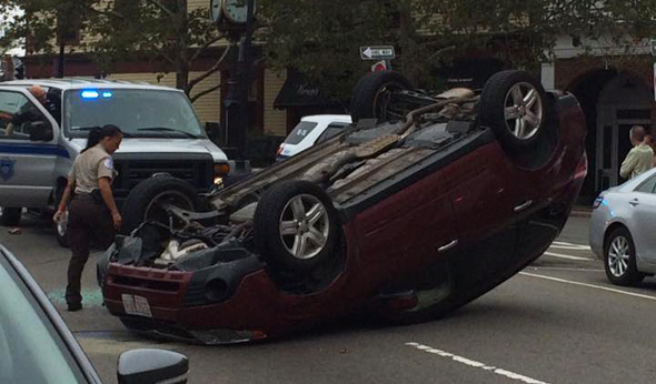Car flipped in Roslindale Square