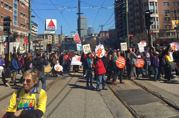 Students march for adjunct professors at BU
