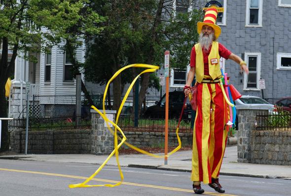 Ribbon guy on stilts in Dorchester Day parade