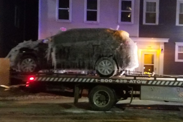 Frozen car towed from Charlestown fire scene