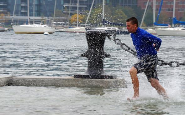 Guy running into Boston Harbor