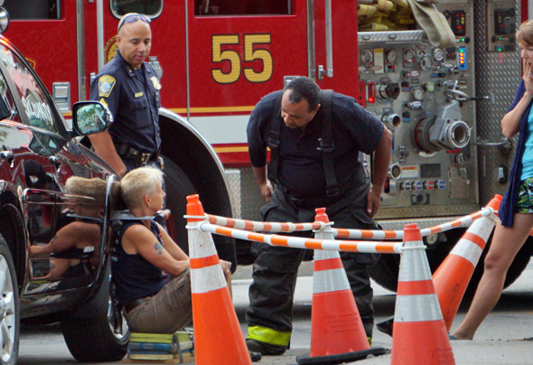 Firefighter talks to protester in West Roxbury