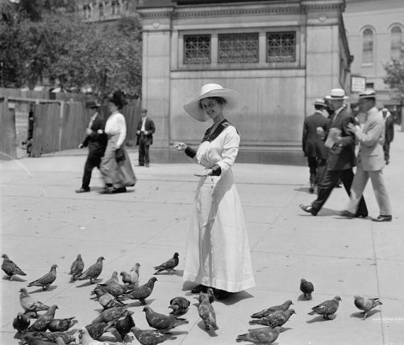 Woman feeding pigeons in Boston