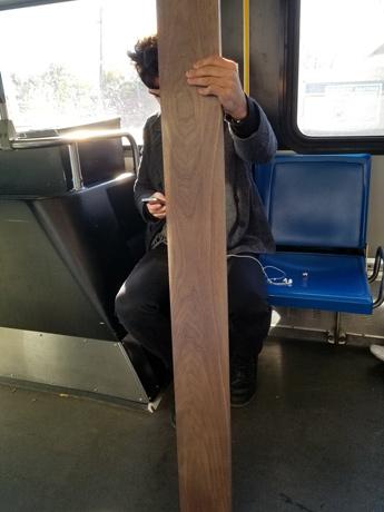 Plank on an MBTA bus