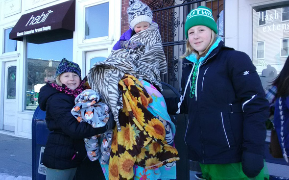 Girls bundled up at the St. Patrick's parade in South Boston